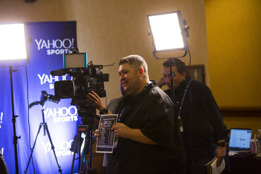 Mike Oz of Yahoo! Sports prepares for an interview during Major League Baseball's winter meetings at Mandalay Bay in Las Vegas on Monday, Dec. 10, 2018. Chase Stevens Las Vegas Review-Journal @css ...