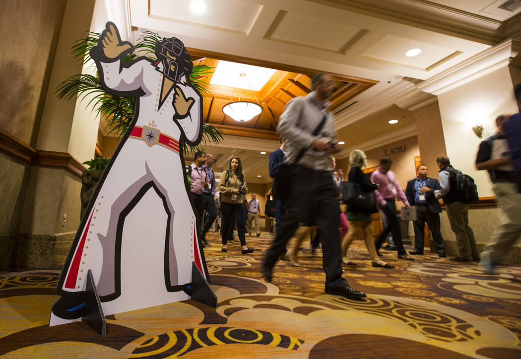 Attendees pass by during Major League Baseball's winter meetings at Mandalay Bay in Las Vegas on Monday, Dec. 10, 2018. Chase Stevens Las Vegas Review-Journal @csstevensphoto