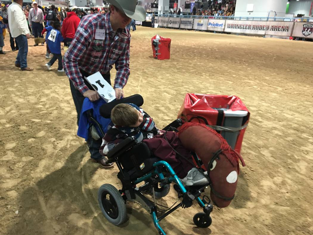 Team roper Cole Davison wheels Jagger Null around a barrel racing course at the Wrangler Rodeo Arena during Monday's Exceptional Rodeo. Null was part of a group of Clark County students who got to ...
