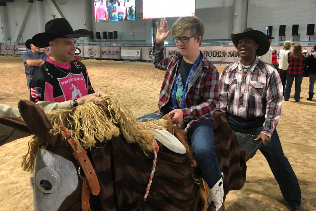 Braden Braunlich takes a ride on Payday, a simulated bucking horse, during the Exceptional Rodeo on Monday at the Wrangler Rodeo Arena inside the Las Vegas Convention Center's South Halls. Braunli ...