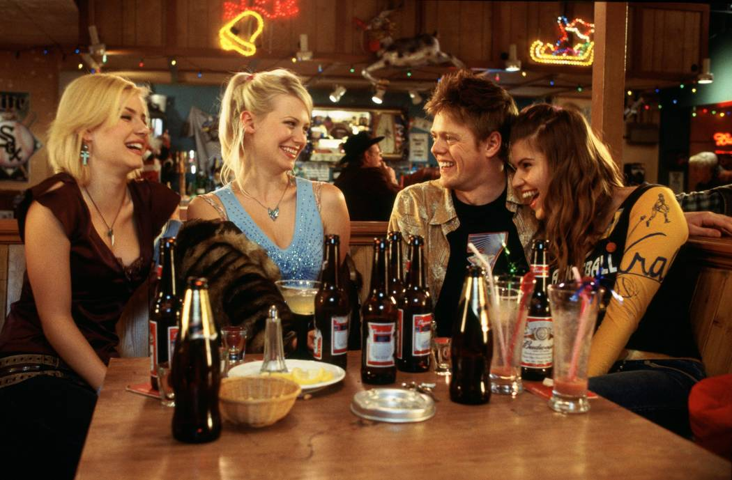 From left, Elisha Cuthbert, January Jones, Kris Marshall and Ivana Milicevic in Richard Curtis' romantic comedy Love Actually. Photo Credit: Peter Mountain ©2003 Universal Studios. All Rights R ...