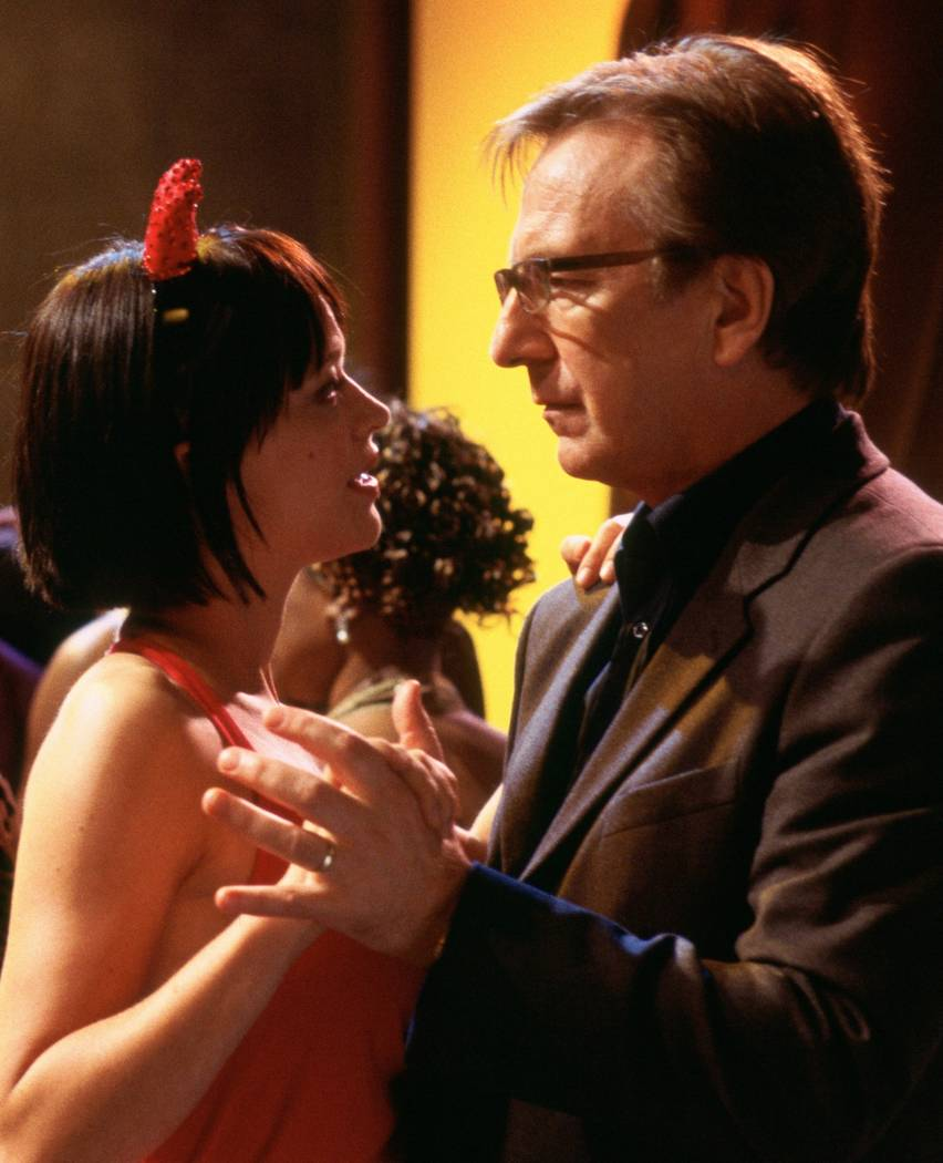 Mia (Heike Makatsch) and Harry (Alan Rickman) Richard Curtis' romantic comedy Love Actually. Photo Credit: Peter Mountain ©2003 Universal Studios. All Rights Reserved.