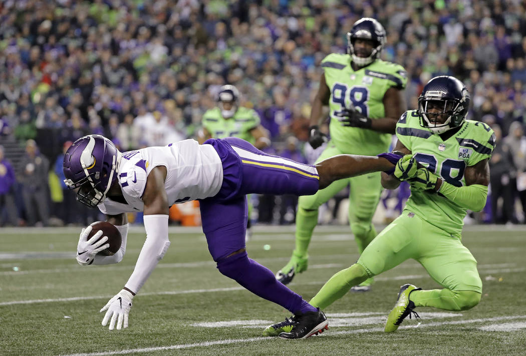 Seattle Seahawks' Justin Coleman, right, brings down Minnesota Vikings' Laquon Treadwell after a pass reception by Treadwell in the second half of an NFL football game, Monday, Dec. 10, 2018, in S ...