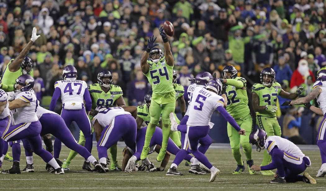 Seattle Seahawks' Bobby Wagner (54) leaps to block a field goal attempt by Minnesota Vikings' Dan Bailey in the second half of an NFL football game, Monday, Dec. 10, 2018, in Seattle. (AP Photo/St ...