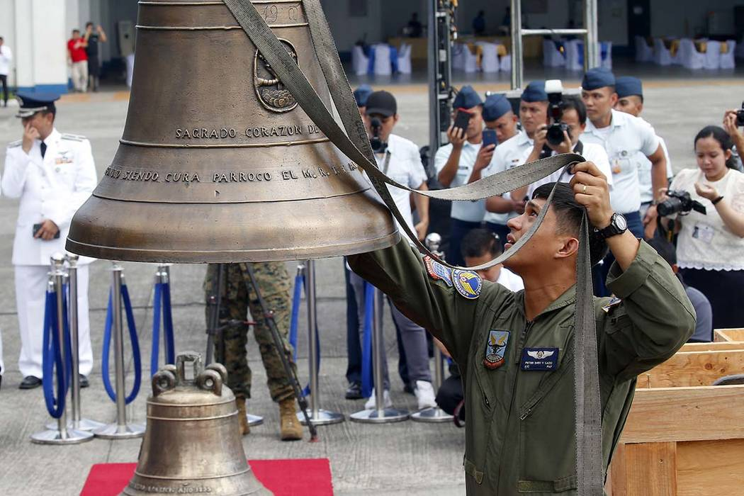 Philippine Air Force personnel unload three church bells seized by American troops as war trophies more than a century ago, as they arrive Tuesday, Dec. 11, 2018 in suburban Pasay city、 southeas ...