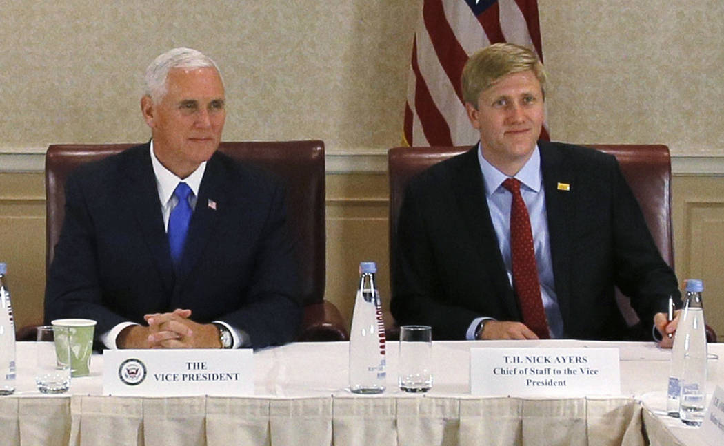 In this Aug. 1, 2017 file photo, Vice President Mike Pence, left, attends a meeting with Georgia opposition leaders in Tbilisi, Georgia. Chief of Staff to the Vice President, Nick Ayers, is right. ...