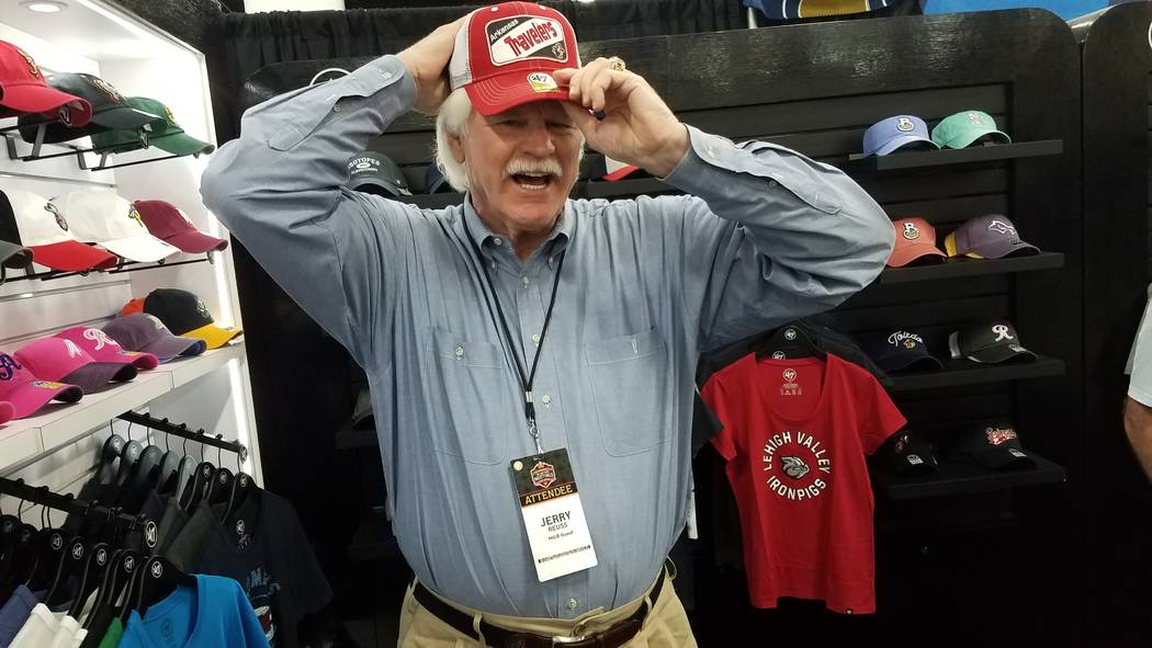 Las Vegas Aviators broadcaster and former major league pitcher Jerry Reuss tries on baseball caps during the trade show at baseball's winter meetings at Mandalay Bay. (Ron Kantowski)