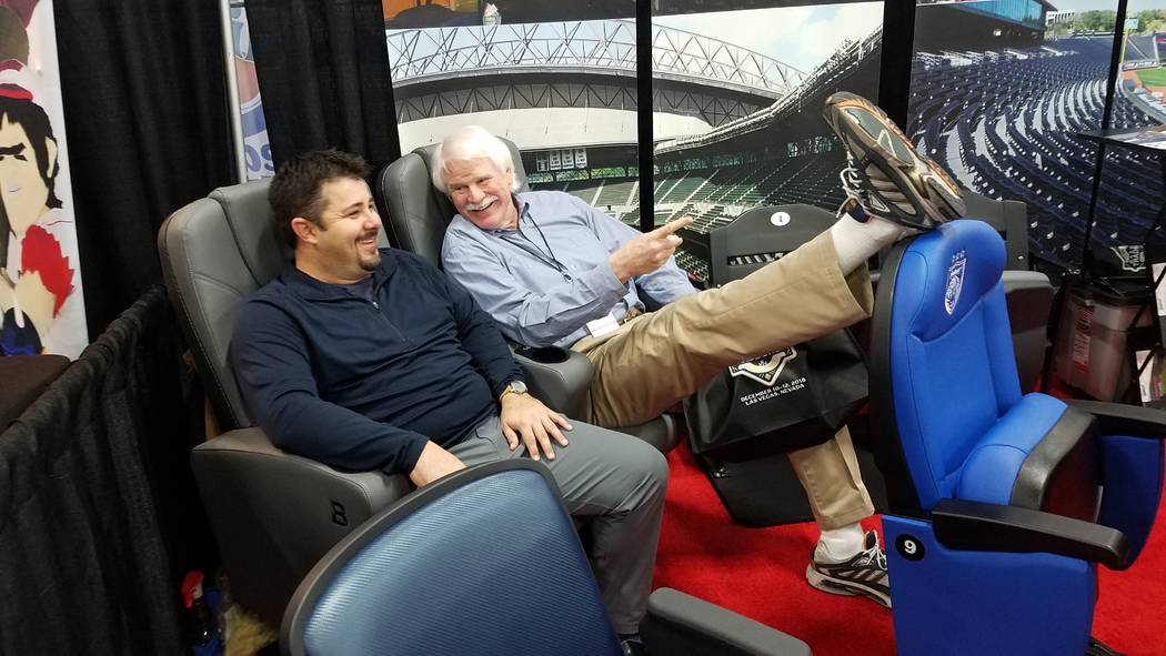 Las Vegas Aviators broadcaster and former major league pitcher Jerry Reuss tries out stadium seats with a baseball fan during the trade show at baseball's winter meetings at Mandalay Bay. (Ron Kan ...