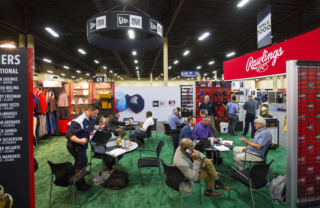Attendees meet at the Rawlings booth during the baseball trade show at Major League Baseball's winter meetings at Mandalay Bay in Las Vegas on Tuesday, Dec. 11, 2018. Chase Stevens Las Vegas Revie ...