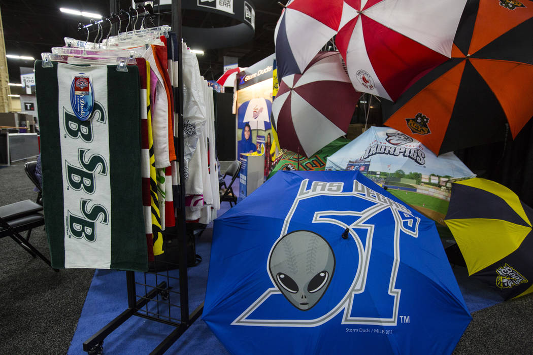 An umbrella shows the former Las Vegas 51s team name and logo during the baseball trade show at Major League Baseball's winter meetings at Mandalay Bay in Las Vegas on Tuesday, Dec. 11, 2018. Chas ...