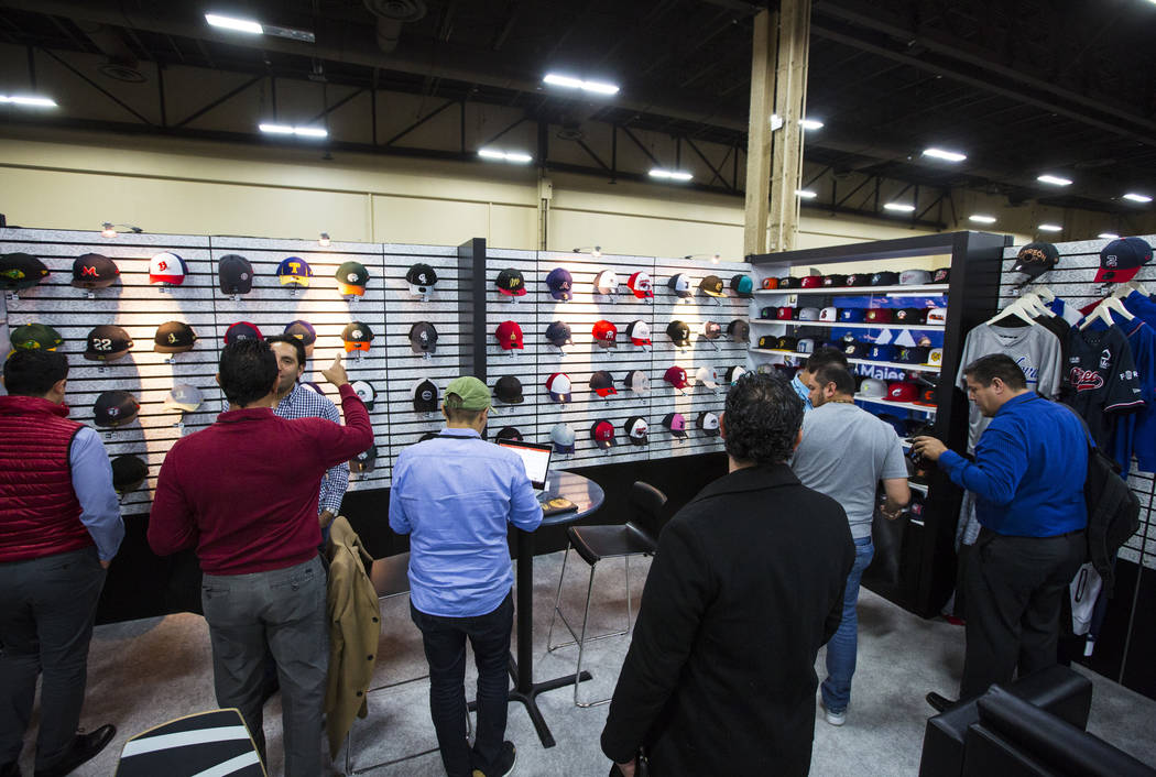 Attendees look through apparel during the baseball trade show at Major League Baseball's winter meetings at Mandalay Bay in Las Vegas on Tuesday, Dec. 11, 2018. Chase Stevens Las Vegas Review-Jour ...