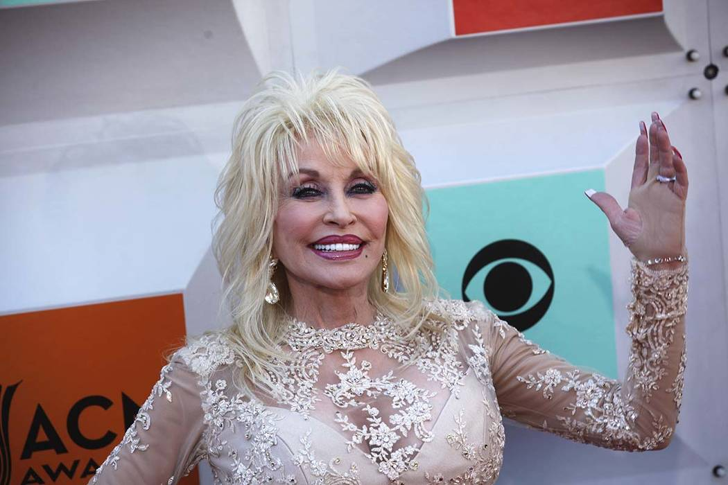 Dolly Parton walks the red carpet at the 51st Academy of Country Music Awards Sunday, April 3, 2016, at the MGM Grand in Las Vegas. (Rachel Aston/Las Vegas Review-Journal) Follow @rookie__rae