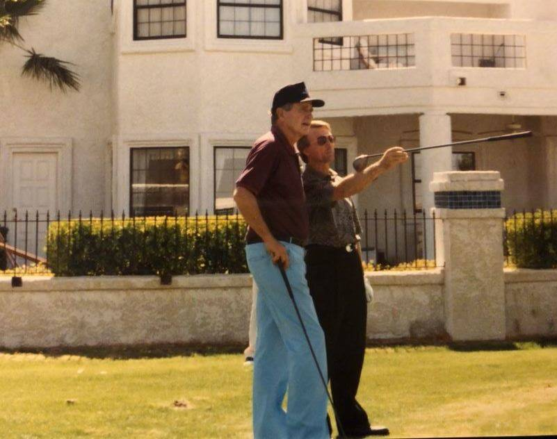 Spanish Trail head pro Jerry Roberts gives advice to George H. W. Bush during a round at Spanish Trail Country Club in 1993. courtesy - Jerry Roberts.