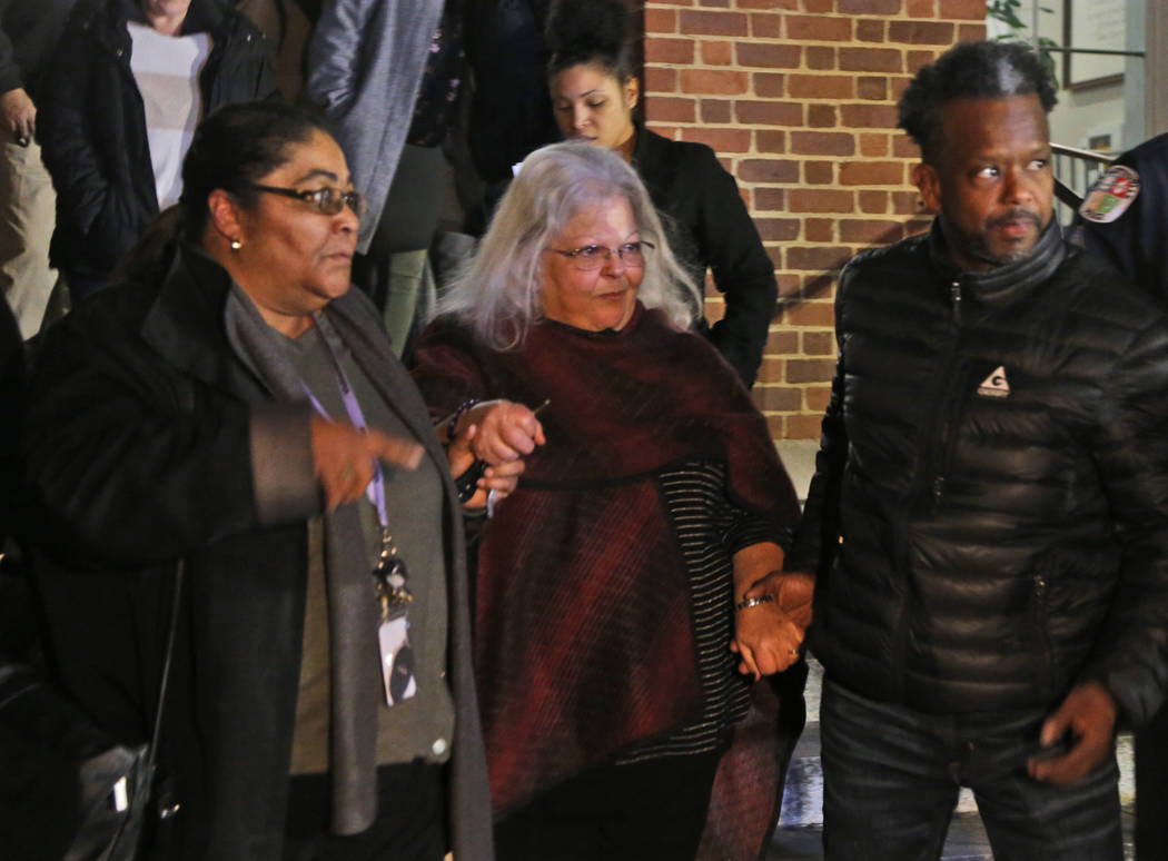 Susan Bro, center, mother of Heather Heyer, is escorted down the steps of the courthouse after a guilty verdict was reached in the trial of James Alex Fields Jr., Friday, Dec. 7, 2018, at Charlott ...