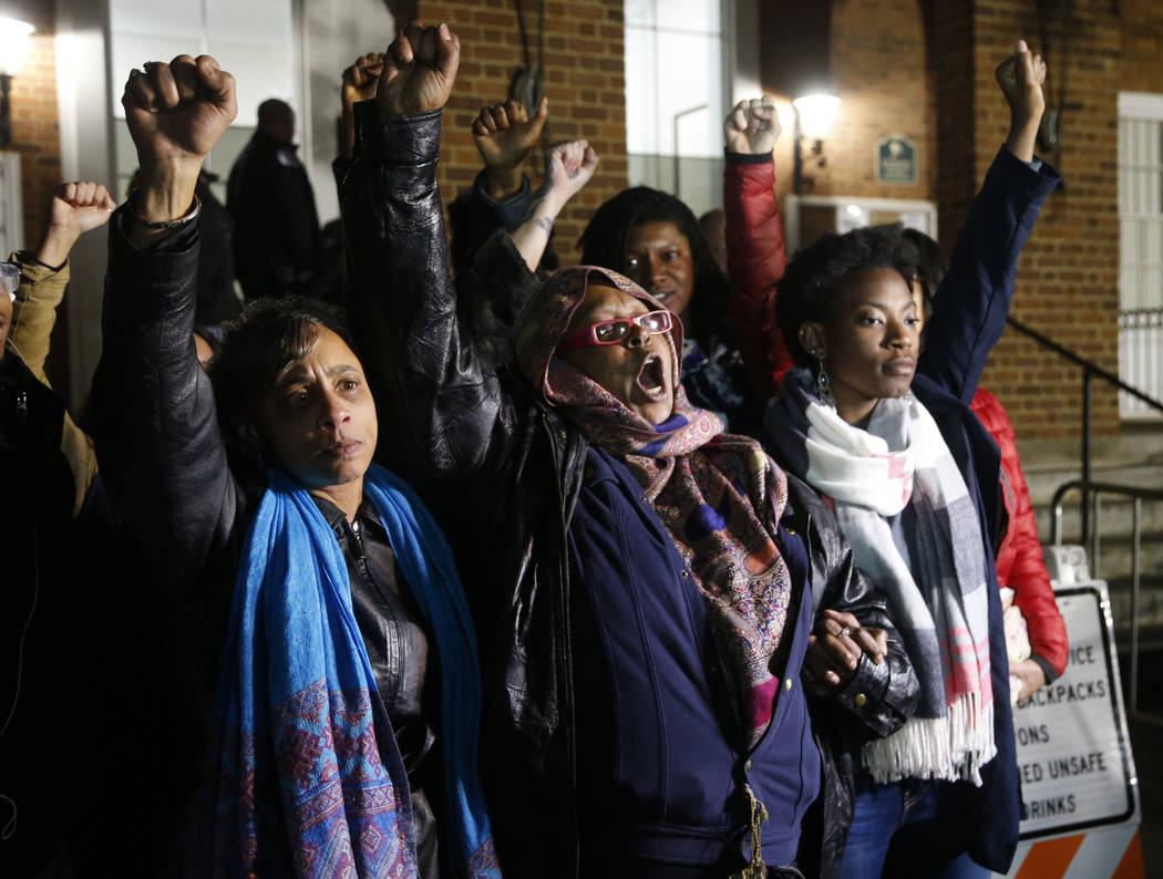 Local activists raise their fists outside Charlottesville General District Court after a guilty verdict was reached in the trial of James Alex Fields Jr., in Charlottesville, Va., Friday, Dec. 7, ...