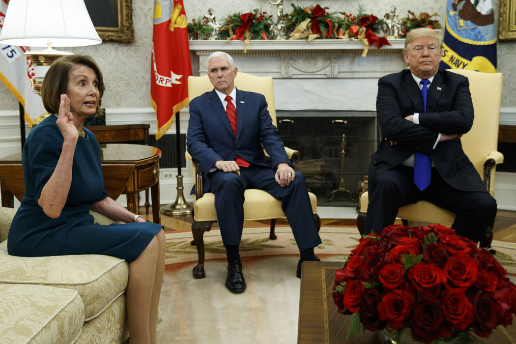 Vice President Mike Pence, center, listens as President Donald Trump argues with House Minority Leader Rep. Nancy Pelosi, D-Calif., during a meeting in the Oval Office of the White House, Tuesday, ...