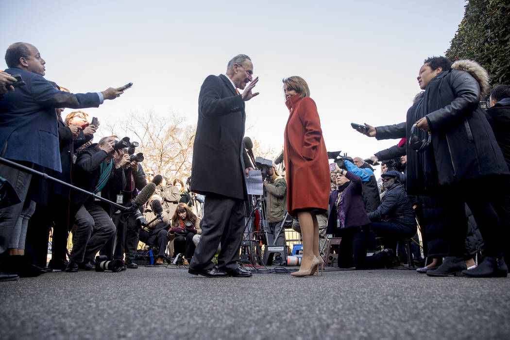 House Minority Leader Nancy Pelosi of California and Senate Minority Leader Sen. Chuck Schumer of New York walk back into the West Wing after speaking to members of the media outside of the White ...