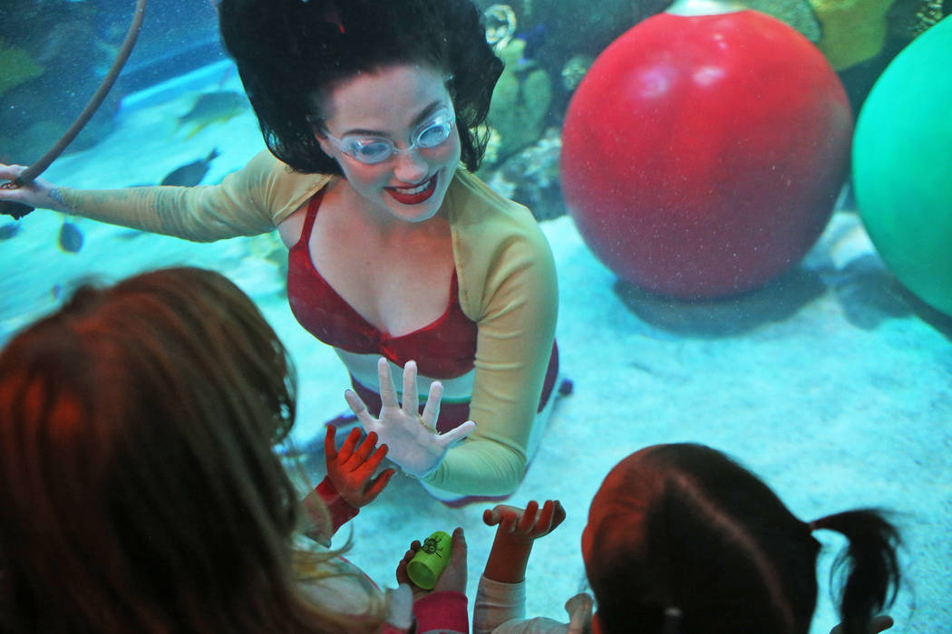 Christmas mermaid Logan Halverson greets children at Silverton hotel and casino in Las Vegas, Sunday, Dec. 2, 2018. She and Santa are in the aquarium every Saturday and Sunday in December from 12 ...