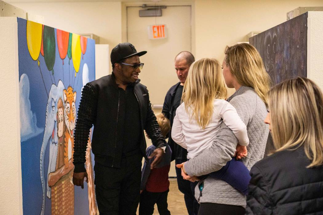 Strip headliner Eddie Griffin tours The Shade Tree Executive Director Stacey Lockhart on Monday, Dec. 10, 2018. (Joshua Chévere Cohen/Prickly Pear Marketing)