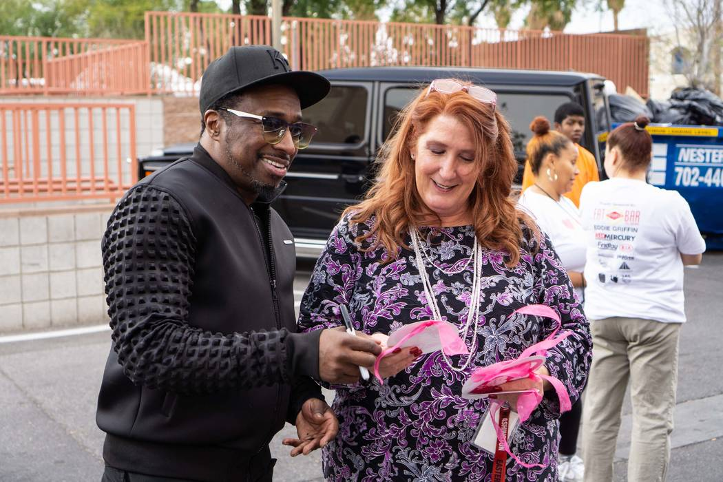Strip headliner Eddie Griffin is shown looking over holiday cards with The Shade Tree Executive Director Stacey Lockhart on Monday, Dec. 10, 2018. (Joshua Chévere Cohen/Prickly Pear Marketing)