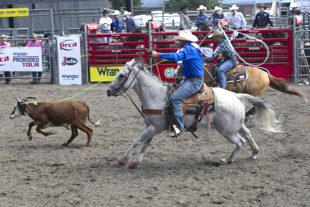 Team roping header Bubba Buckaloo, front, pursues a steer with heeling partner Tyler Worley at a rodeo in Puyallup, Wash., in September. Buckaloo qualified among the top 15 headers to reach the Wr ...