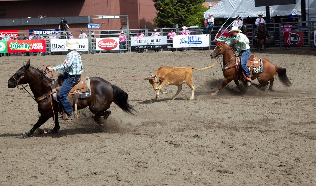 Heeler Cole Davison, right, finishes off a run with header Kolton Schmidt at a rodeo in Puyallup, Wash., in September. Davison finished the regular season 13th among heelers to qualify for the Wra ...