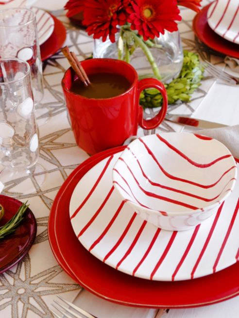 Vietri's Stripe collection in red and white creates a festive statement on its own or paired with Lastra red dinner plate. (Vietri)