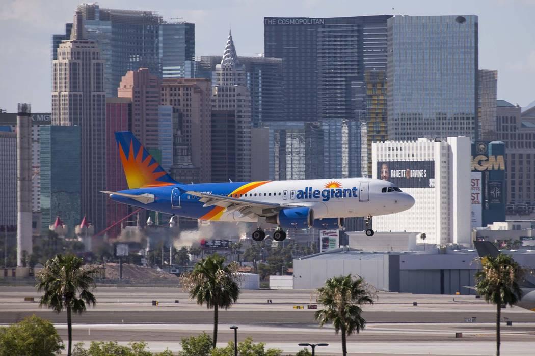 An Allegiant Air flight lands at McCarran International Airport in Las Vegas. (Richard Brian/Las Vegas Review-Journal) @vegasphotograph