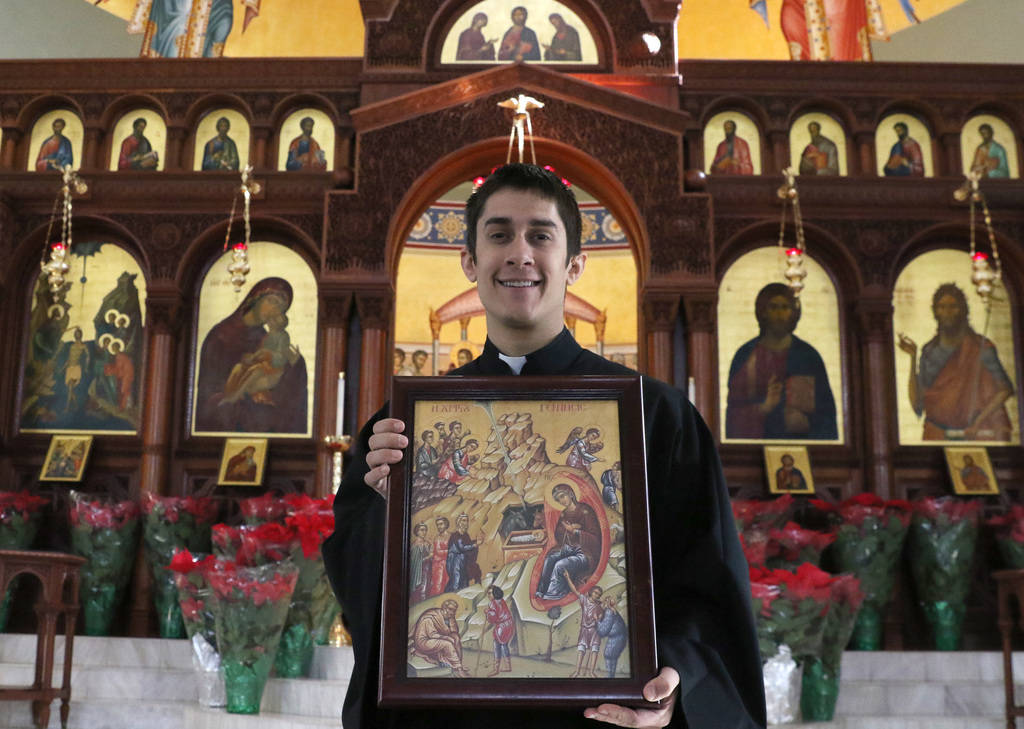 Rev. Father Seraphim Ramos holds the icon of the Birth of Jesus christ as he poses for a photo at St. John the Baptist Greek Orthodox Church on Friday, Dec, 14, 2018, in Las Vegas. Bizuayehu Tesfa ...