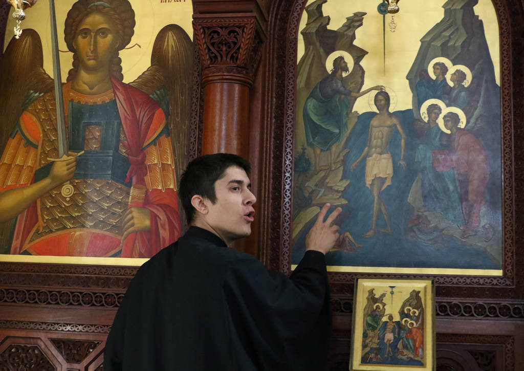 Rev. Father Seraphim Ramos talks about Greek Orthodox icons during an interview with the Las Vegas Review-Journal at St. John the Baptist Greek Orthodox Church on Friday, Dec, 14, 2018, in Las Veg ...