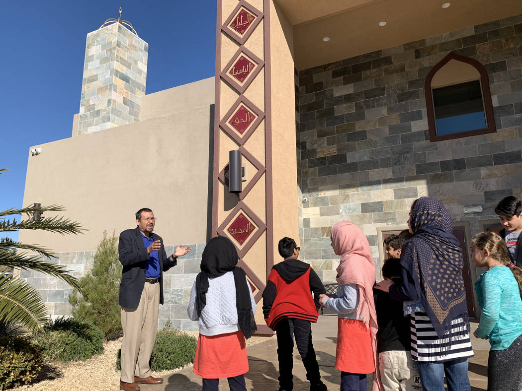 Shamsuddin Waheed, imam and director of Masjid Ibrahim Islamic Center, teaches Sunday School students about panels featuring some of the 99 Names of Allah surrounding the entrance to center in Las ...