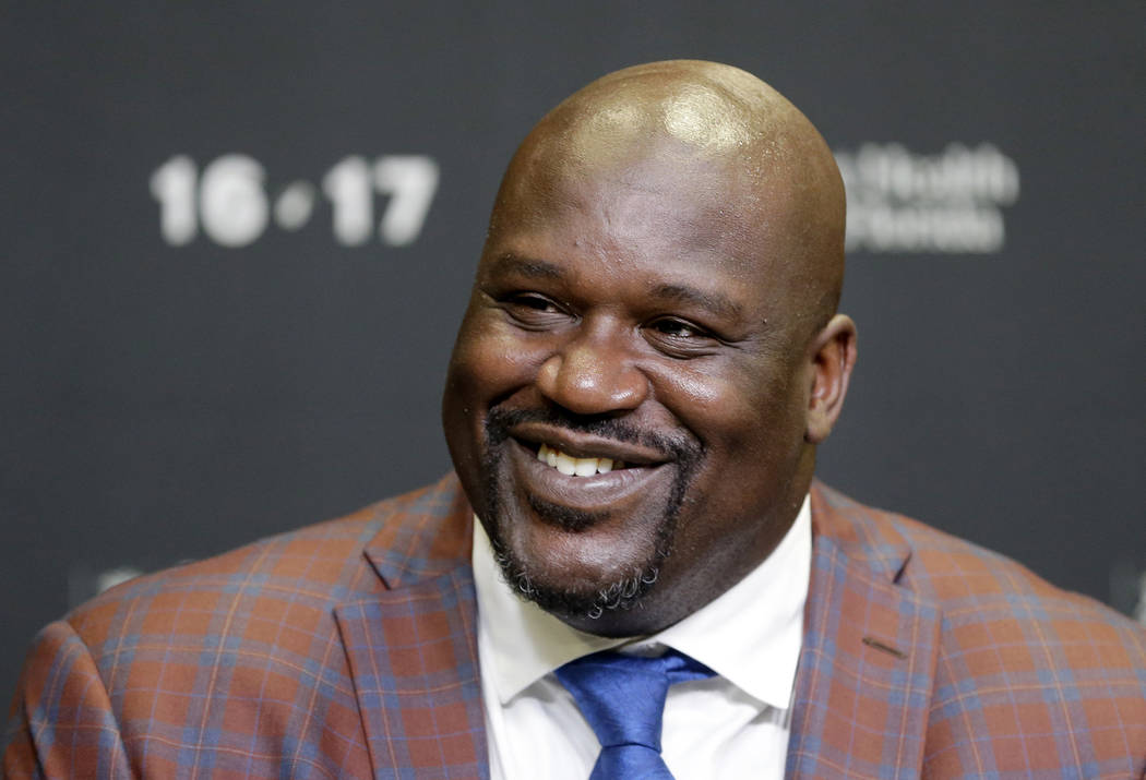 In this Dec. 22, 2016, file photo, retired Hall of Fame basketball player Shaquille O'Neal smiles as he talks to reporters during an NBA basketball news conference in Miami. (AP Photo/Alan Diaz, File)
