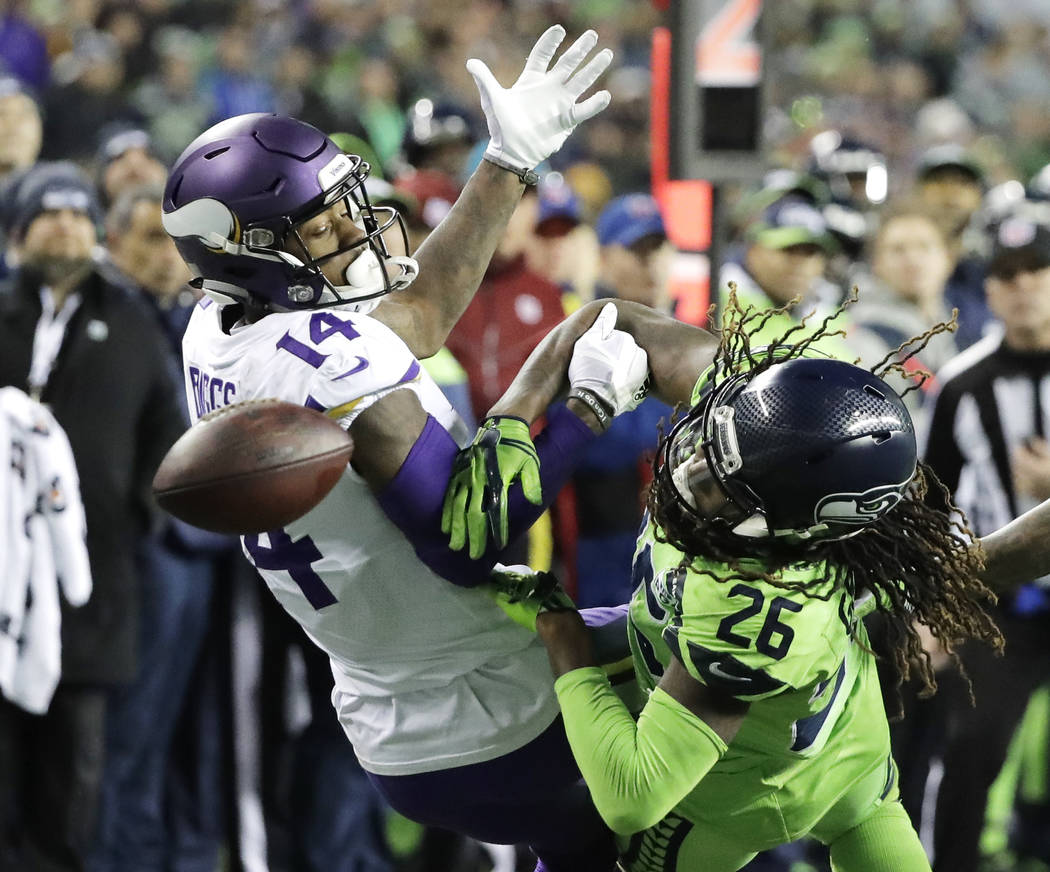 Seattle Seahawks cornerback Shaquill Griffin (26) breaks up a pass intended for Minnesota Vikings wide receiver Stefon Diggs (14) in the second half of an NFL football game, Monday, Dec. 10, 2018, ...
