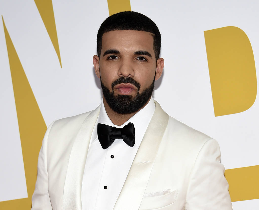 """In this June 26, 2017 file photo, Canadian rapper Drake arrives at the NBA Awards in New York. Drake's song """"In My Feelings,"""" was named as one of the top songs of the year by Associated Press Mus ..."""