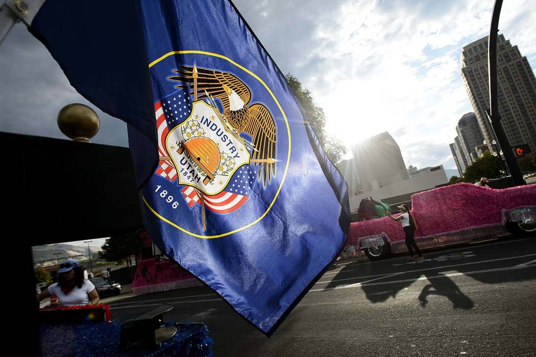 The Utah state flag waves in the morning sun at the start of the Days of '47 Parade in Salt Lake City, July 24, 2017. A Utah state lawmaker is leading an effort to redesign a clunky Utah state fla ...