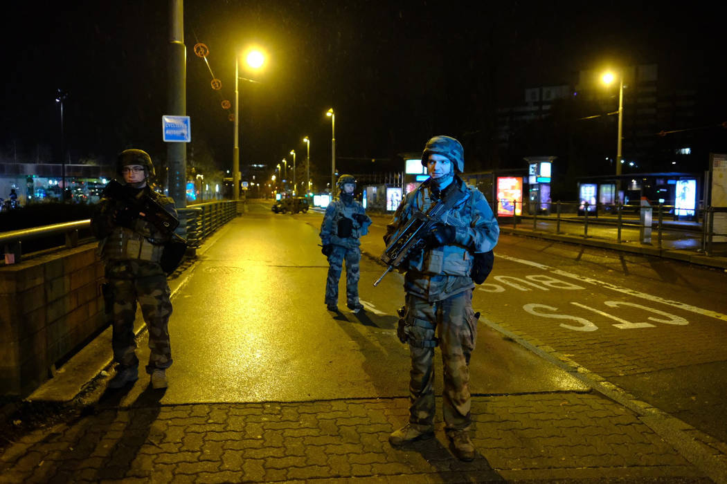 Soldiers patrol in Strasbourg, eastern France, after a shooting Tuesday Dec.11, 2018. French prosecutors say a terror investigation has been opened into the shooting at a Christmas market in Stras ...