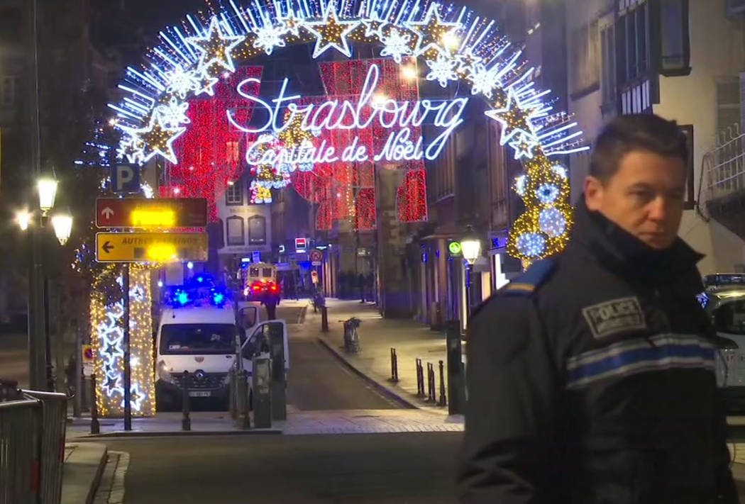 In this image made from video, emergency services arrive on the scene of a Christmas market in Strasbourg, France, Tuesday, Dec. 11, 2018. A French regional official says that a shooting in Strasb ...