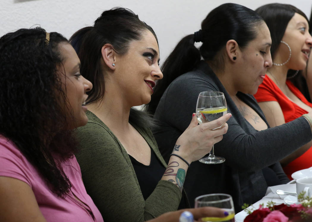 Danielle Sherland, second left, chats as Jaemillah Eagans, left, looks on during an elegant tea party at WestCare Women and Children Campus on Tuesday, Dec. 11, 2018, in Las Vegas. Bizuayehu Tesfa ...