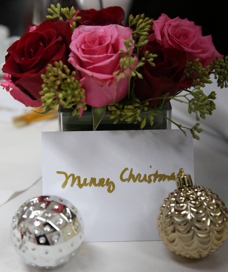 A bouquet of roses and a gift card are displayed where women enjoy an elegant tea party at WestCare Women and Children Campus on Tuesday, Dec. 11, 2018, in Las Vegas. Bizuayehu Tesfaye Las Vegas R ...