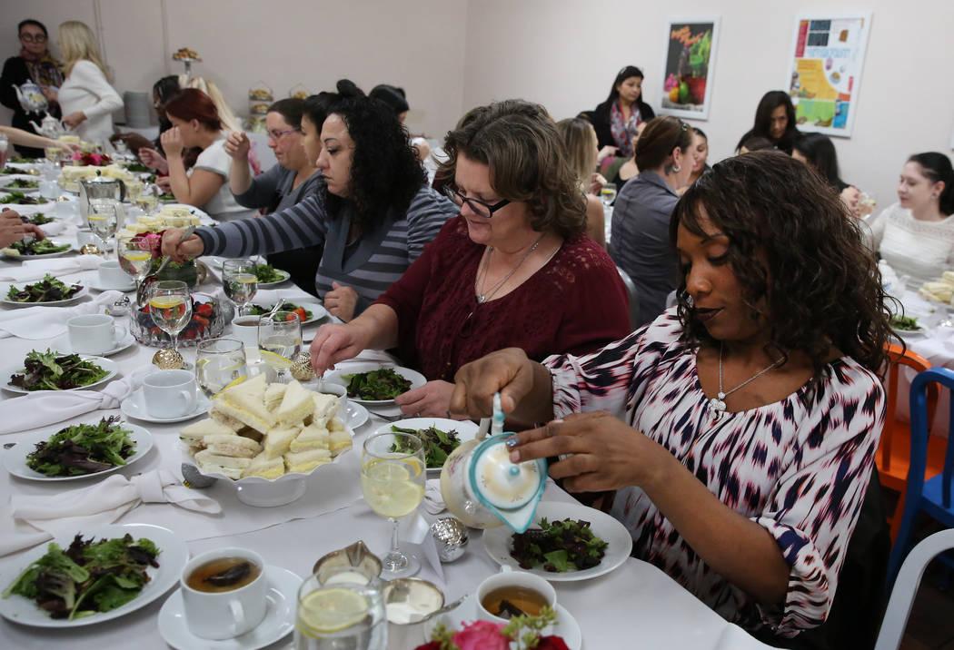 Women, including Tina Marie, right, enjoy an elegant tea party at WestCare Women and Children Campus on Tuesday, Dec. 11, 2018, in Las Vegas. Bizuayehu Tesfaye Las Vegas Review-Journal @bizutesfaye