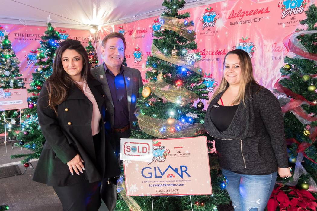 GLVAR board members, from left, Jillian Batchelor, Tim Kelly Kiernan and Amber Diskin were on hand Dec. 10 to show support for another record-breaking year of the KLUC Toy Drive. (GLVAR)