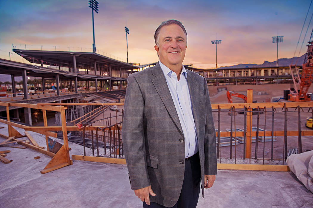 Don Logan, president and chief operating officer of the Las Vegas Aviators, and wife, Jen, are longtime residents of Summerlin. He stands near the construction site of the Las Vegas Ballpark. (Su ...