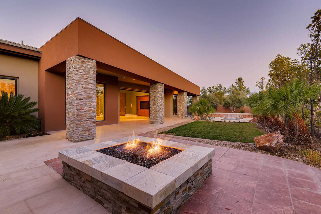 The backyard showcases a fire feature. (Affluent Agency)