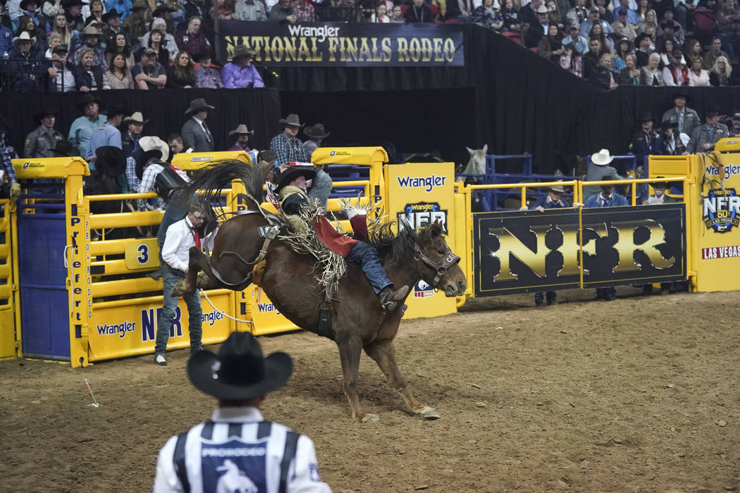 Ty Breuer of Mandan, N.D. competes in the bareback riding event during the sixth go-round of the National Finals Rodeo at the Thomas & Mack Center in Las Vegas on Tuesday, Dec. 11, 2018. Richa ...