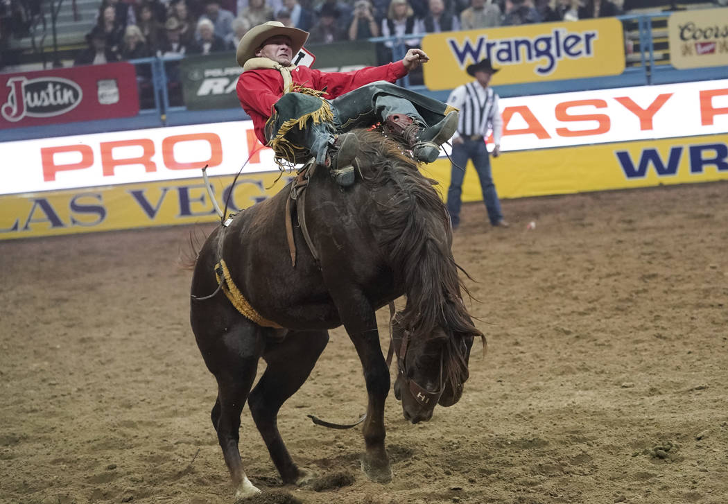 Will Lowe of Canyon, Texas competes in the bareback riding event during the sixth go-round of the National Finals Rodeo at the Thomas & Mack Center in Las Vegas on Tuesday, Dec. 11, 2018. Rich ...