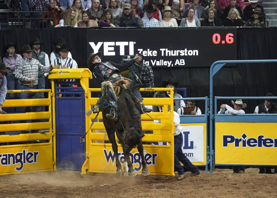 Zeke Thurston of Alberta, Canada competes in the saddle bronc riding event during the sixth go-round of the National Finals Rodeo at the Thomas & Mack Center in Las Vegas on Tuesday, Dec. 11, ...