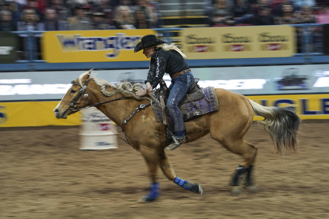 Hailey Kinsel of Cotulla, Texas competes in the barrel racing event during the sixth go-round of the National Finals Rodeo at the Thomas & Mack Center in Las Vegas on Tuesday, Dec. 11, 2018. R ...