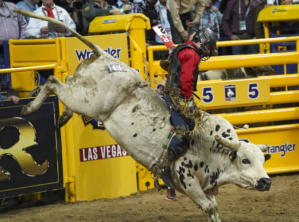 Dustin Boquet of Bourg, La. competes in the bull riding event during the sixth go-round of the National Finals Rodeo at the Thomas & Mack Center in Las Vegas on Tuesday, Dec. 11, 2018. Richard ...