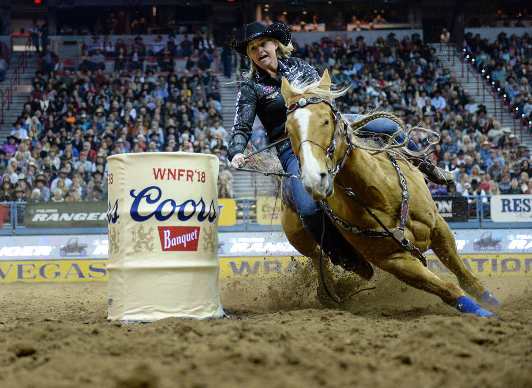 Ivy Conrado of Hudson, Colo. (107) competes in barrel racing during the sixth go-round of the National Finals Rodeo at the Thomas & Mack Center in Las Vegas, Tuesday, Dec. 11, 2018. Caroline B ...