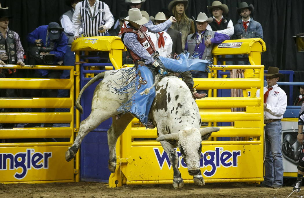 Roscoe Jarboe of New Plymouth, Idaho rides JBC Teckno Crepe in the bull riding competition during the ninth go-round of the National Finals Rodeo, Friday, Dec. 15, 2017, at the Thomas & Mack Cente ...